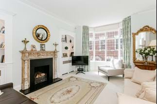 an elegant Victorian townhouse drawing room