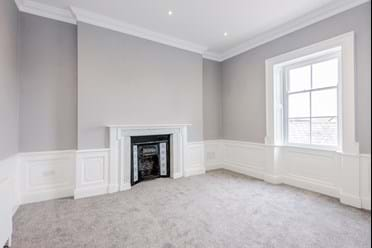 bedroom with sash windows in townhouse for sale