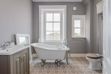 period style bathroom with free-standing bath