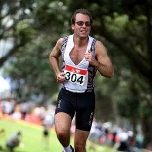Tim Rickitt competing in a triathalon