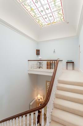 staircase and decorative skylight in period house