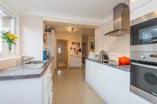 a contemporary kitchen in a bungalow for sale with Rickitt Partnership