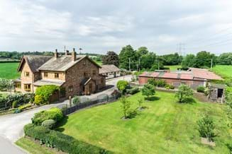 A detached country house with land for sale in Cheshire