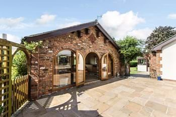 Summer house marketed for sale with a detached house in Crowton Cheshire
