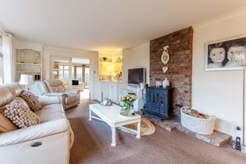 drawing room with fire in family house for sale with Chester estate agents Rickitt Partnership