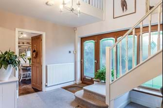 A hall in a detached family home for sale with Cheshire estate agent Rickitt Partnership