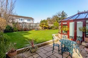 a garden and patio with a detached house for sale with estate agent Chester Rickitt Partnership