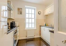 a kitchen in a modern town house for sale in Chester with Chester estate agency Rickitt Partnership