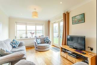 a sitting room in a modern detached house for sale  with Rickitt Partnership Chester estate agency