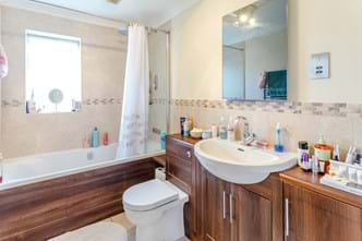 A family bathroom in a detached house for sale with Rickitt Partnership Chester estate agents