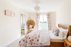 A contemporary bedroom in a house for sale with Chester estate agent Rickitt Partnership