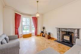 A drawing room or sitting room in a Victorian period house for sale with estate agent Chester, Rickitt Partnership