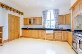 A kitchen with authentic bell rings in a Victorian period house for sale with estate agency Chester, Rickitt Partnership