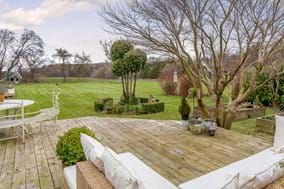 Garden and decking area with period house for sale at Rickitt Partnership Chester estate agent