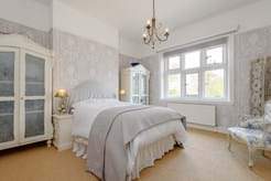 Bedroom in a period manor house for sale with Chester estate agency Rickitt Partnership