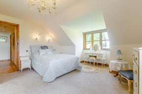 A bedroom in a detached house for sale in Marford with estate agency Chester Rickitt Partnership