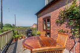 A terrace seating area with a house for sale in Clutton with Chester estate agent Rickitt Partnership