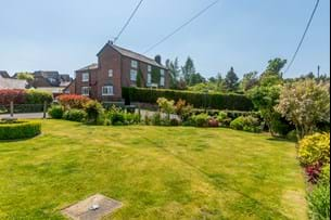 A garden at a barn conversion for sale with Chester estate agent Rickitt Partnership