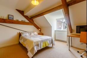 A bedroom in a barn conversion for sale at Chester estate agency Rickitt Partnership