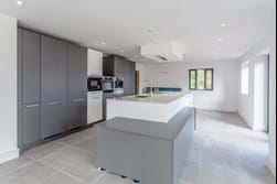 open plan kitchen in a new build house for sale in Kelsall with Rickitt Partnership Chester estate agent