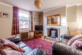 The sitting room in a semi-detached house for sale in Holt