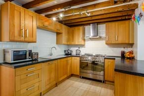 The kitchen in a semi-detached period house for sale in Holt
