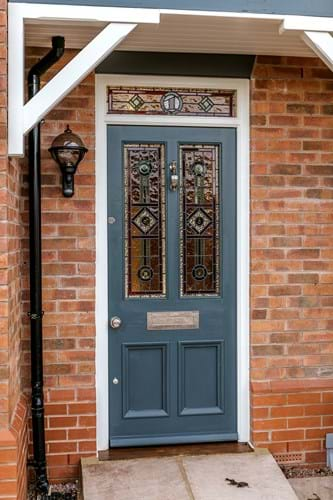 a front door with stained glass window panels
