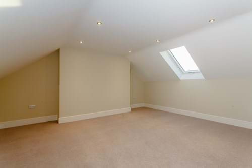 the attic bedroom in a new-build house for sale in Waverton near Chester