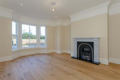 the sitting room with bay window in a semi-detached house for sale in Waverton near Chester