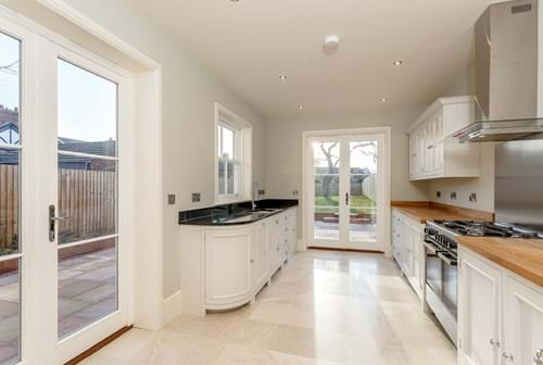 The Neptune kitchen in a semi-detached new build house for sale in Waverton.  Marketed by Rickitt Partnership estate agents