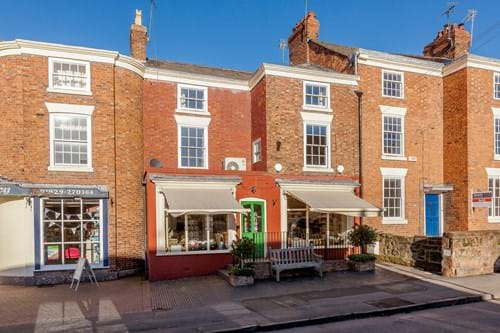 A georgian three storey property for sale in Farndon, encompassing a shop and apartment