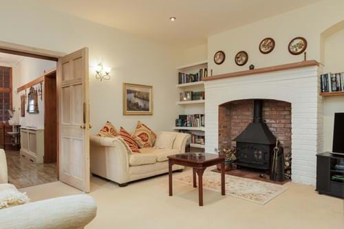 the sitting room in a period property for sale with Chester estate agents Rickitt Partnership