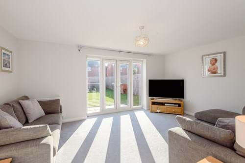 the sitting room in a modern house for sale in Farndon
