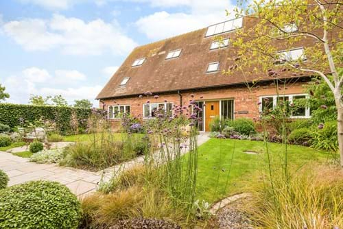 A barn conversion for sale in Poulton