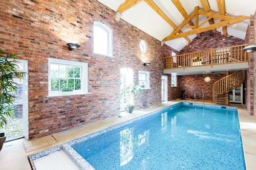 The swimming pool at a Georgian house for sale near Eaton with Rickitt Partnership Chester estate agent