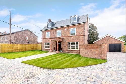 a detached new build Georgian style house for sale in Bunbury Heath
