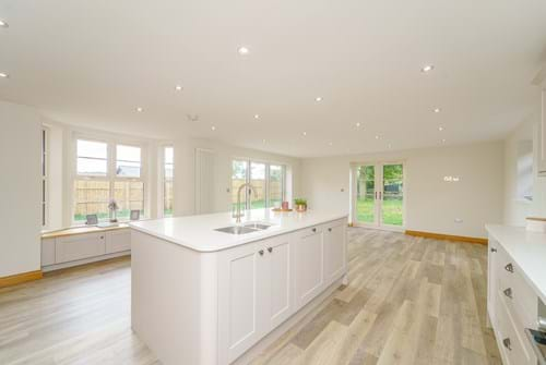 the open plan kitchen in a house for sale with shaker style kitchen units