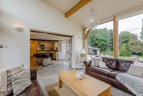the family room in a barn conversion for sale in Tattenhall