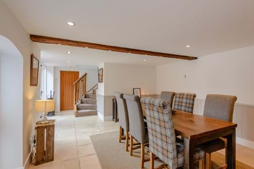 an open plan dining room and hall in a barn conversion for sale in Tattenhall