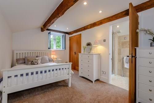 A bedroom with en suite shower room in a house for sale in Tattenhall