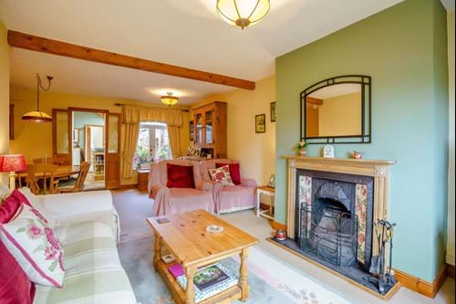 The living/dining room in a terraced houe for sale in Huxley, Cheshire
