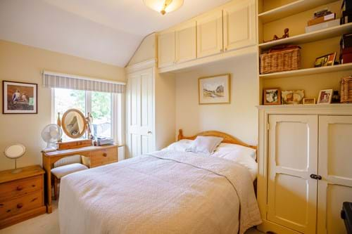 A bedroom in a period terraced cottage for sale with Chester estate agency Rickitt Partnership