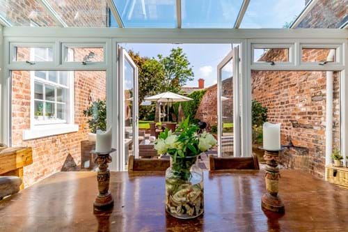 a garden room opening onto a paved terrace in a period townhouse for sale with Chester estate ageny Rickitt Partnership