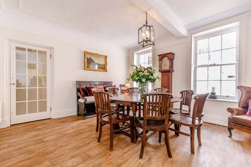 The dining room in a period townhouse for sale in Chester marketed by Rickitt Partnership estate agency