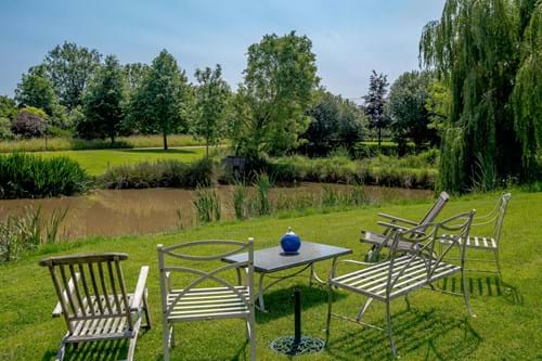 The garden overlooking one of three ponds at a Georgian house for sale with Chester estate agency Rickitt Partnership