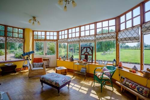 a sunroom overlooking gardens in a Georgian house for sale with Chester estate agent Rickitt Partnership