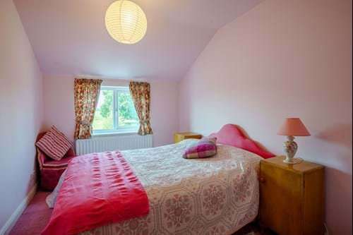the bedroom in an annexe within a Georgian detached family house for sale near Chester