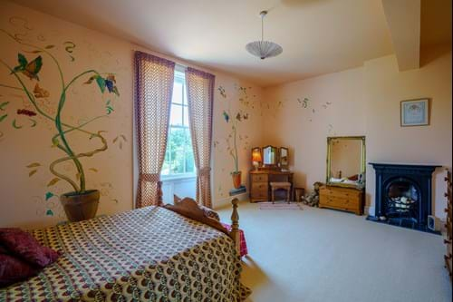 a large bedroom in a Georgian house for sale in Hargrave.  On the market with Rickitt Partnership estate agents