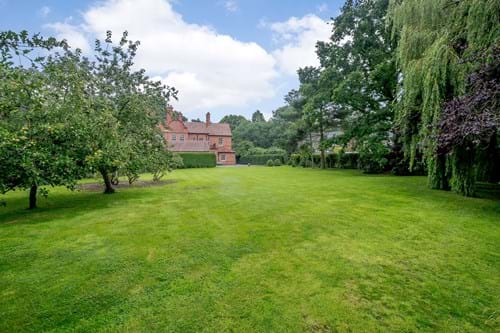 The large lawned garden at a period house for sale in Chester