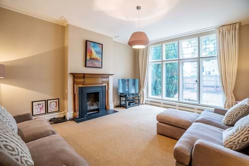 the drawing room in a family house for sale in Hough Green